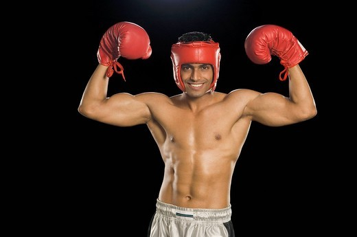 Stock Photo: 1657R-32352 Boxer with arms raised in celebration