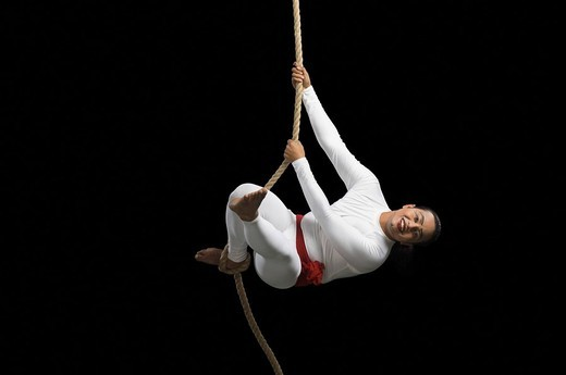 Acrobat performing on a rope : Stock Photo