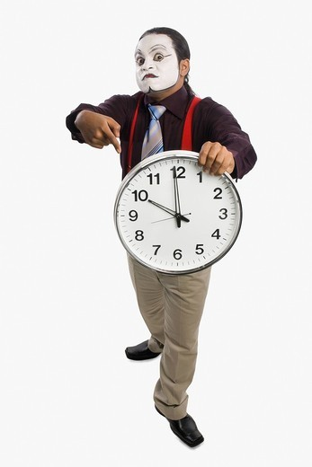 Mime showing a clock : Stock Photo