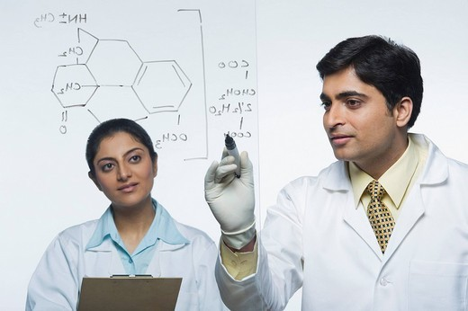 Scientists at work on a problem : Stock Photo