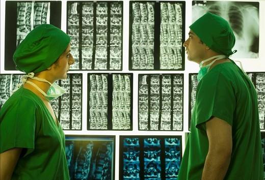 Surgeons examining X_Ray report : Stock Photo