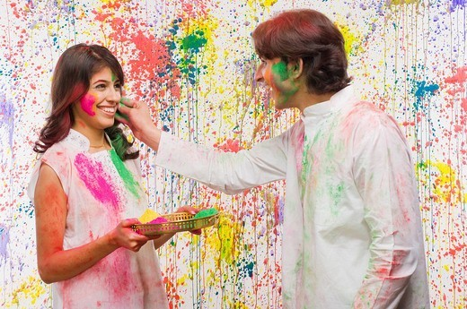 Man applying colors on a woman´s face : Stock Photo
