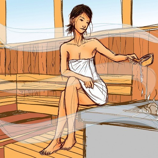 Woman sitting in a sauna : Stock Photo