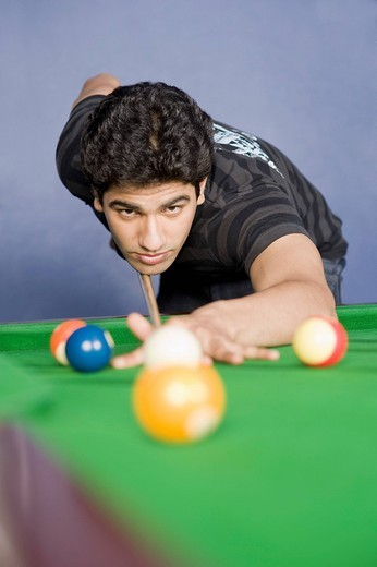 Young man playing pool : Stock Photo