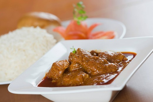 Close_up of vindaloo meat curry served with rice : Stock Photo