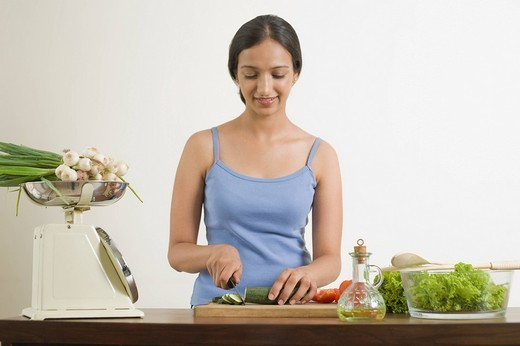 Woman preparing food in the kitchen : Stock Photo