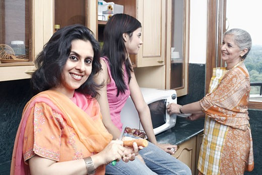 Stock Photo: 1657R-3414 Three women talking in the kitchen