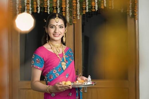 Woman holding Diwali thali : Stock Photo