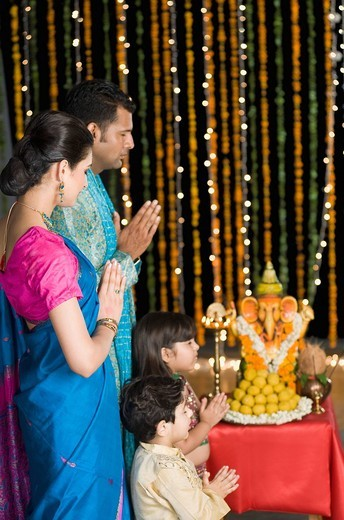 Family praying at Diwali : Stock Photo