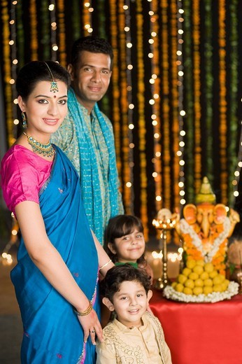 Family celebrating Diwali : Stock Photo