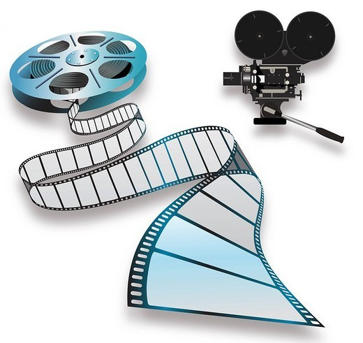 Close_up of a film reel and camera : Stock Photo