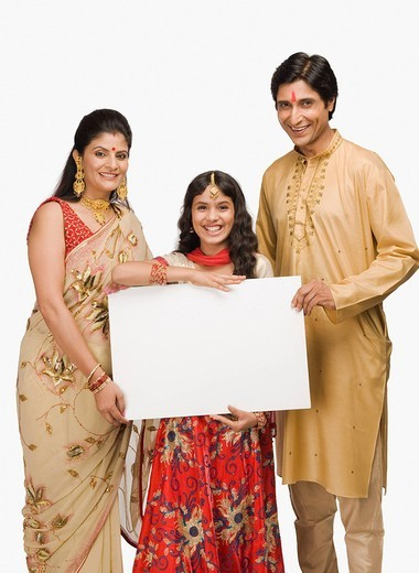 Portrait of a couple with their daughter holding a placard : Stock Photo