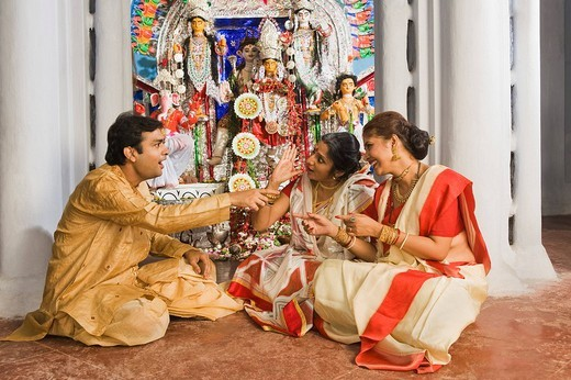 Family sitting in a temple : Stock Photo