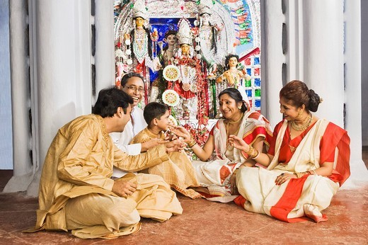Stock Photo: 1657R-34575 Family sitting in a temple