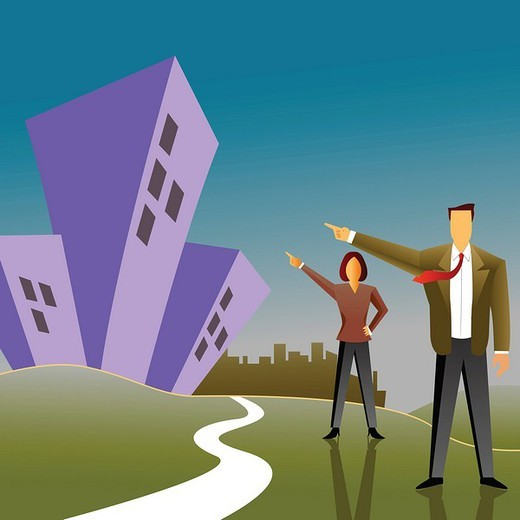 Businessman with a businesswoman pointing towards apartments : Stock Photo