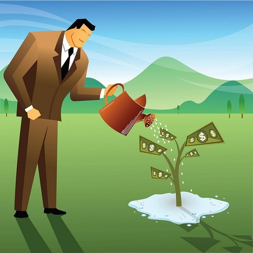 Businessman watering a money plant : Stock Photo