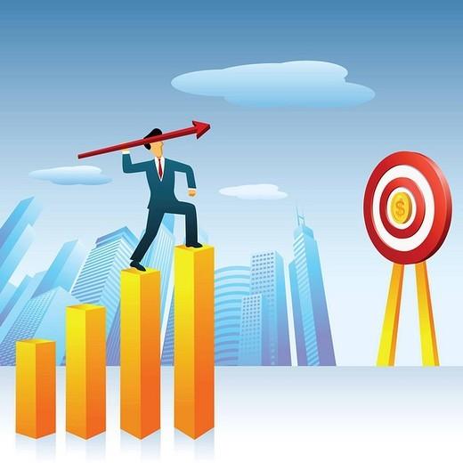 Businessman throwing an arrow to a dartboard : Stock Photo