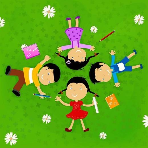 Children lying on grass : Stock Photo