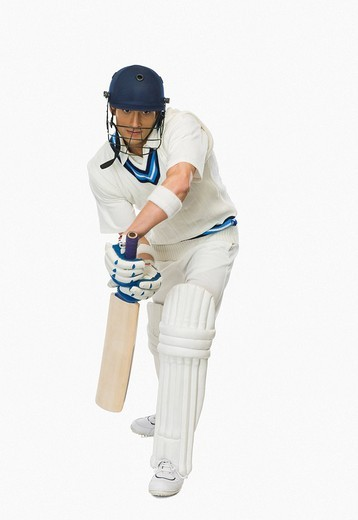 Cricket batsman playing forward defensive stroke : Stock Photo