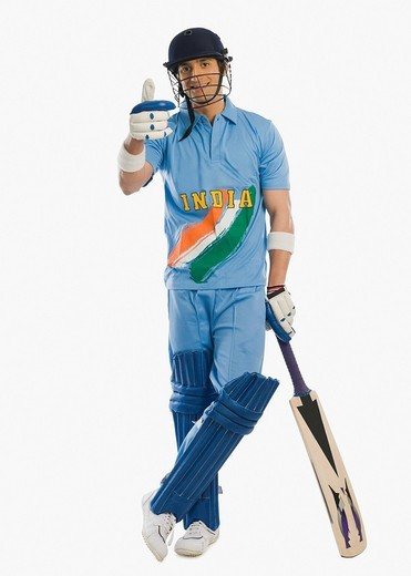 Cricket batsman standing at the non striker end and showing thumbs up sign : Stock Photo