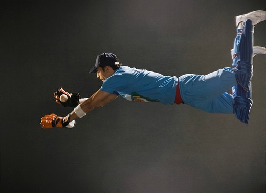 Stock Photo: 1657R-35718 Wicket keeper diving to catch a ball