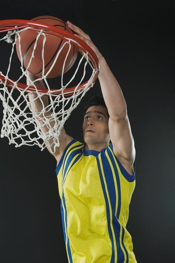 Basketball player dunking a ball : Stock Photo