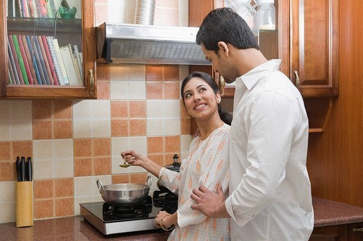 Couple cooking in the kitchen : Stock Photo