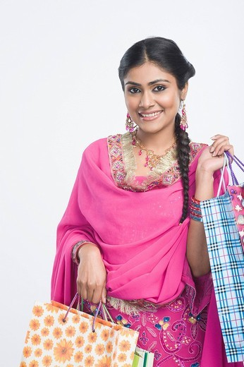 Stock Photo: 1657R-36058 Woman carrying shopping bags and smiling