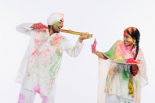 Stock Photo: 1657R-36071 Couple celebrating Holi
