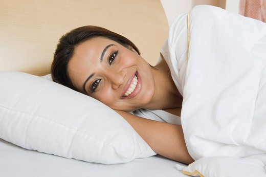 Woman lying on the bed : Stock Photo