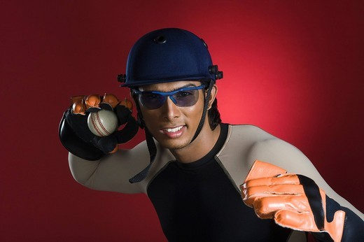Wicket keeper throwing a cricket ball : Stock Photo