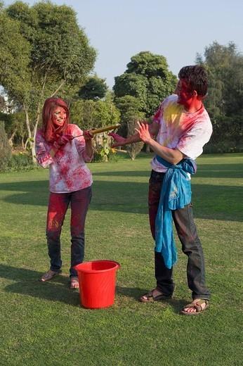 Couple celebrating Holi : Stock Photo