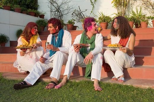 Stock Photo: 1657R-36440 Friends celebrating Holi