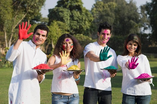 Stock Photo: 1657R-36485 Friends showing their colored hands on Holi