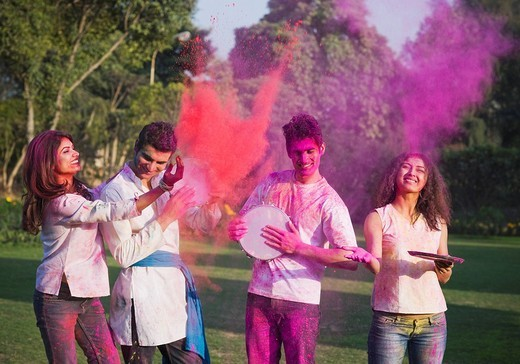 Friends celebrating Holi : Stock Photo