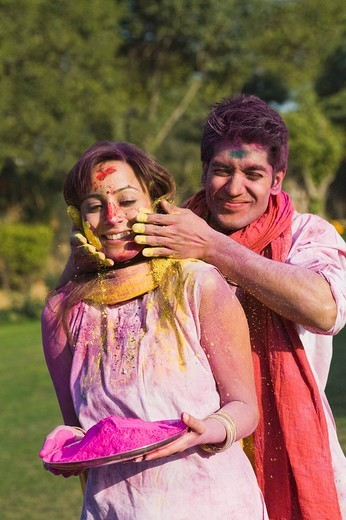 Couple celebrating Holi with colors : Stock Photo