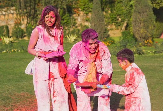 Stock Photo: 1657R-36604 Family celebrating Holi with colors