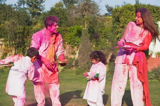 Family celebrating Holi with colors : Stock Photo