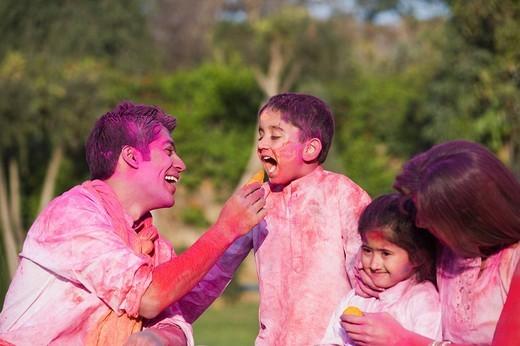 Stock Photo: 1657R-36660 Couple celebrating Holi with their children