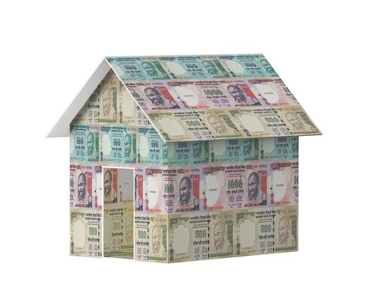 Close_up of a model house made from Indian currency : Stock Photo