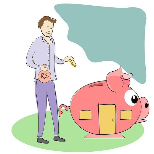 Businessman putting money into a piggy bank house : Stock Photo