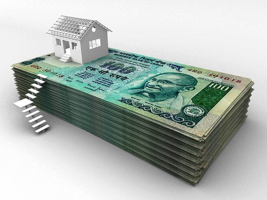 House on top of stack of hundred rupee banknotes : Stock Photo