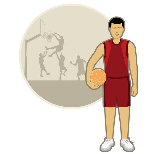 Basketball player holding a basketball : Stock Photo