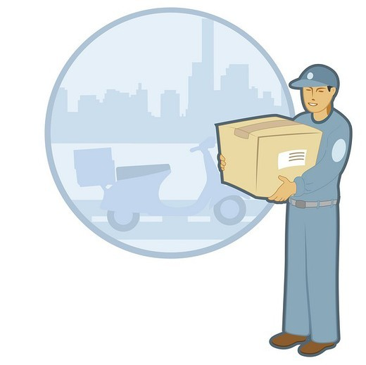 Messenger holding a cardboard box : Stock Photo