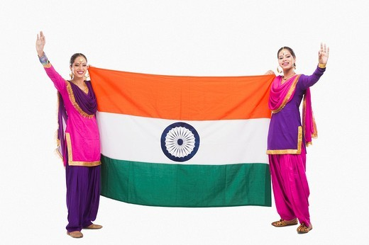 Stock Photo: 1657R-37026 Female Bhangra dancers holding an Indian flag