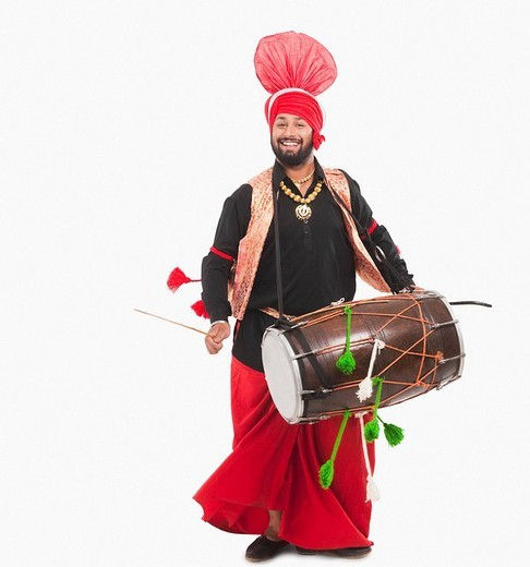 Man performing Bhangra dance with a dholak : Stock Photo