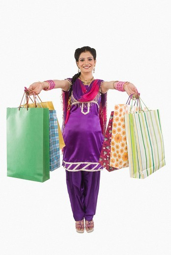 Woman showing shopping bags : Stock Photo