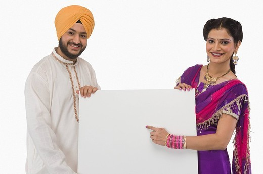 Stock Photo: 1657R-37131 Portrait of a Sikh couple showing a blank placard