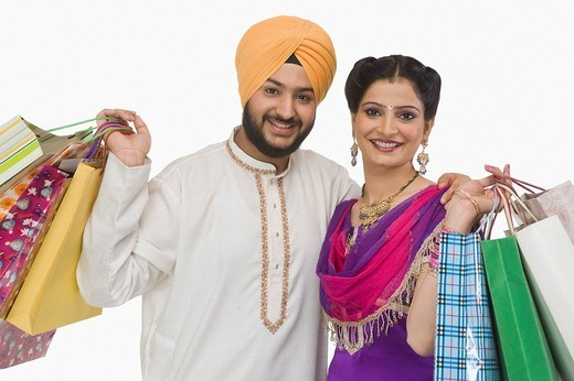 Portrait of a Sikh couple carrying shopping bags : Stock Photo