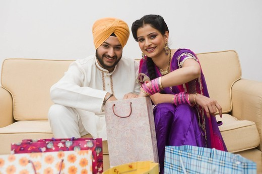 Sikh couple checking shopping bags : Stock Photo
